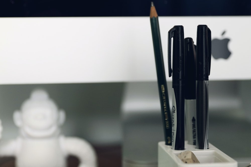 pen and pencil in organizer close-up photography