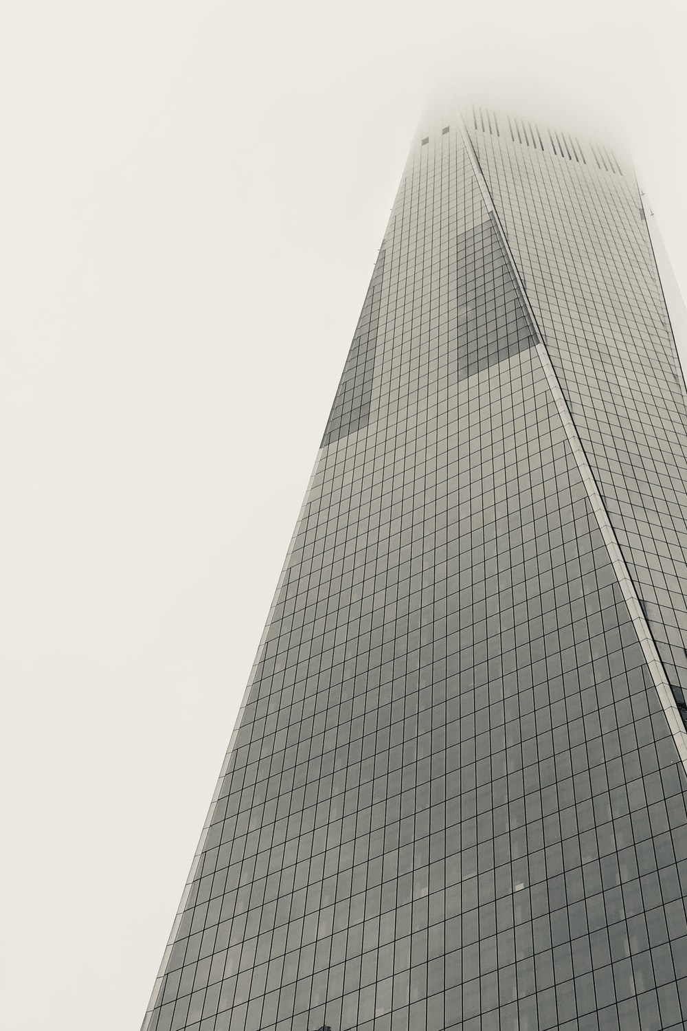low-angle photography of glass high-rise building