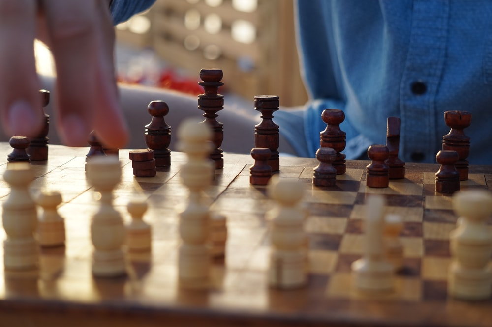 beige and brown chess board game set