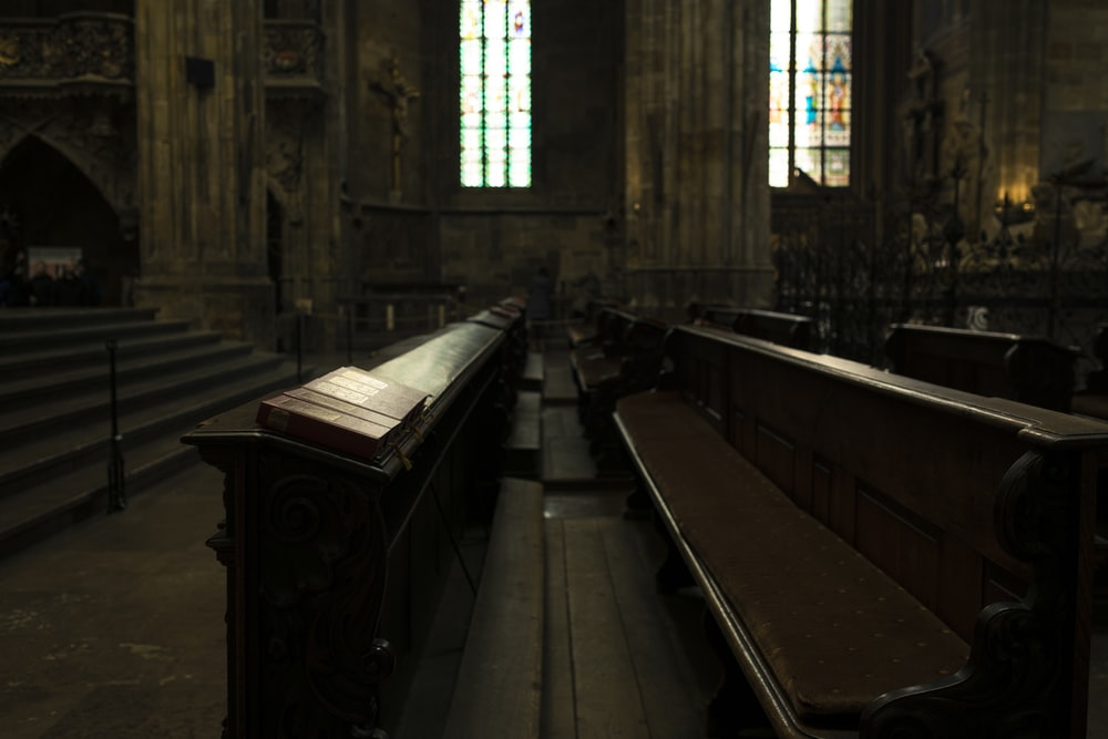 brown wooden cathedral bench