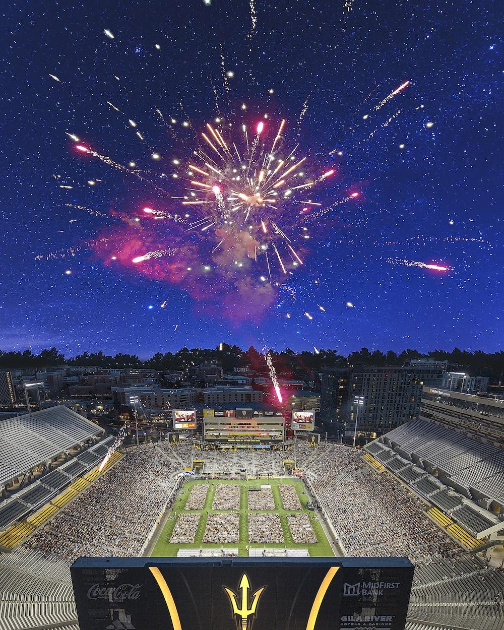 aerial view of people in stadium watching fireworks