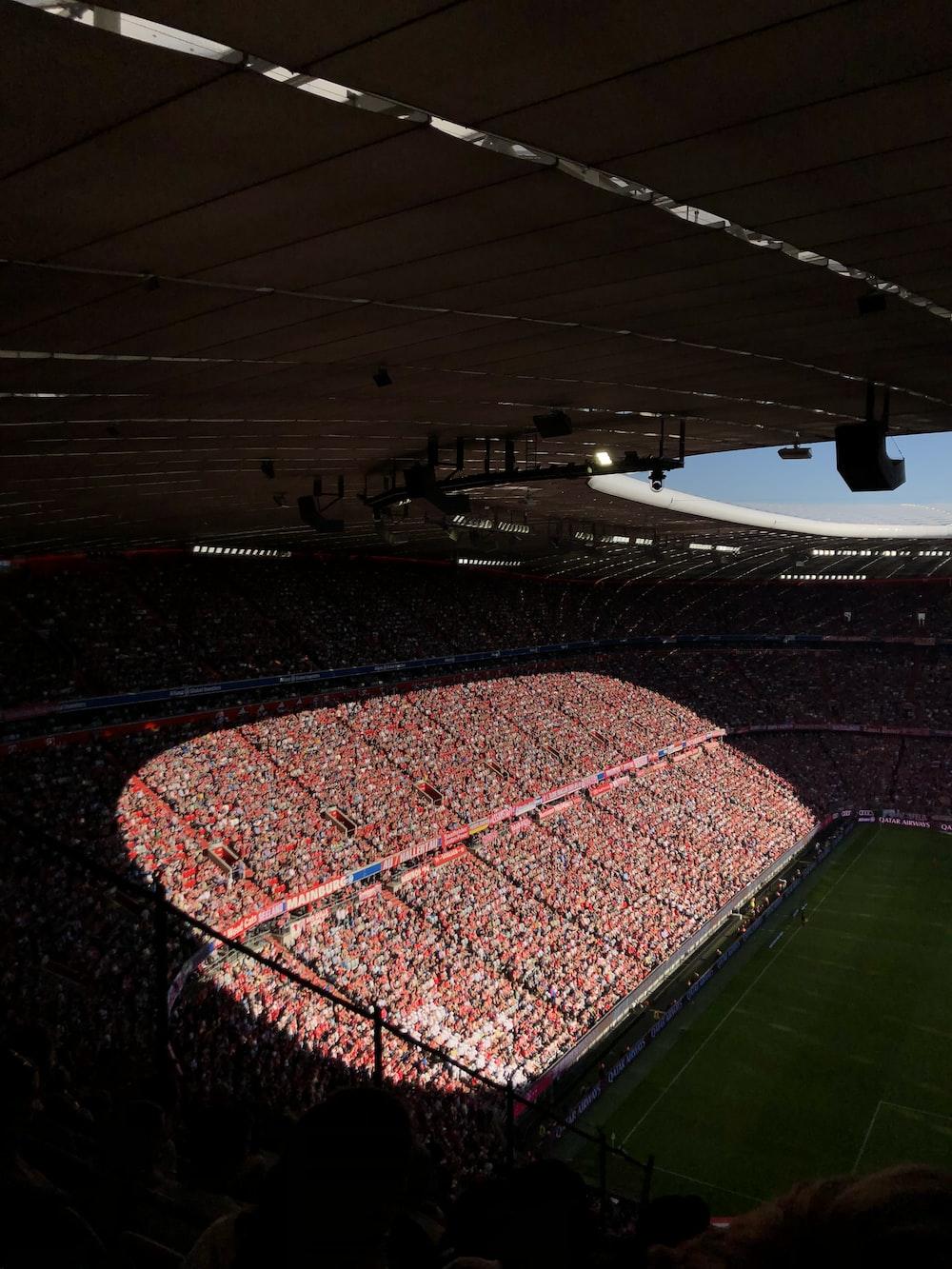 people gathering inside stadium during daytime