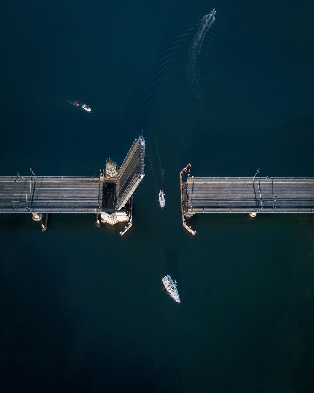 boat crossing on the bridge aerial view