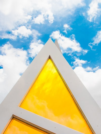 low-angle photography of yellow and white building during daytime