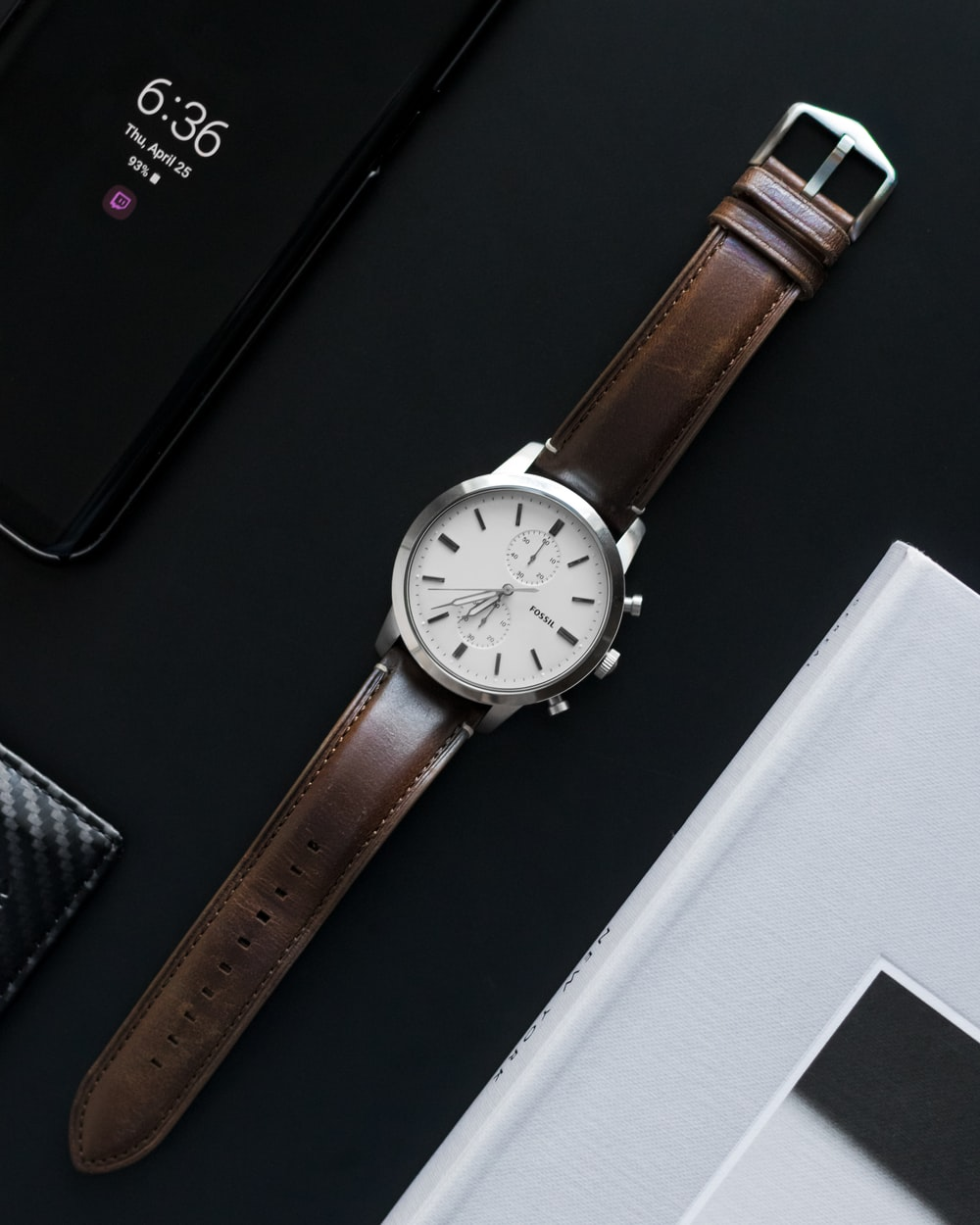 round gray analog watch with brown band