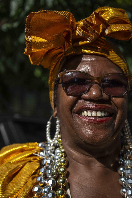 smiling woman wearing brown sunglasses