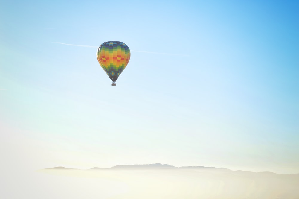blue, yellow, and red hot air balloon