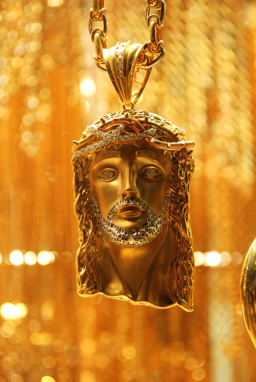 gold-colored Jesus Christ pendant