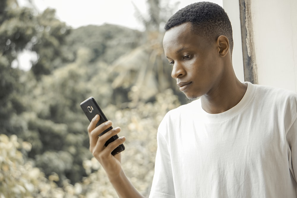 man using black smartphone