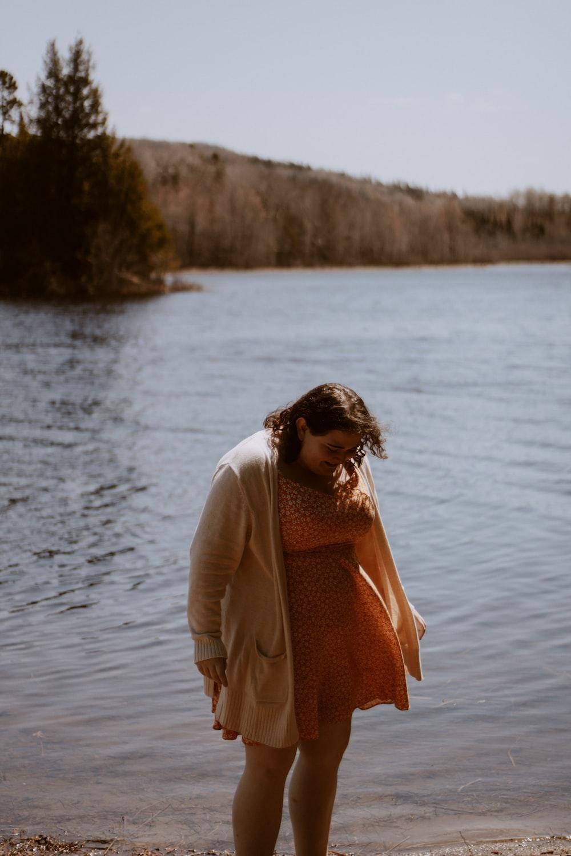 woman standing near shore