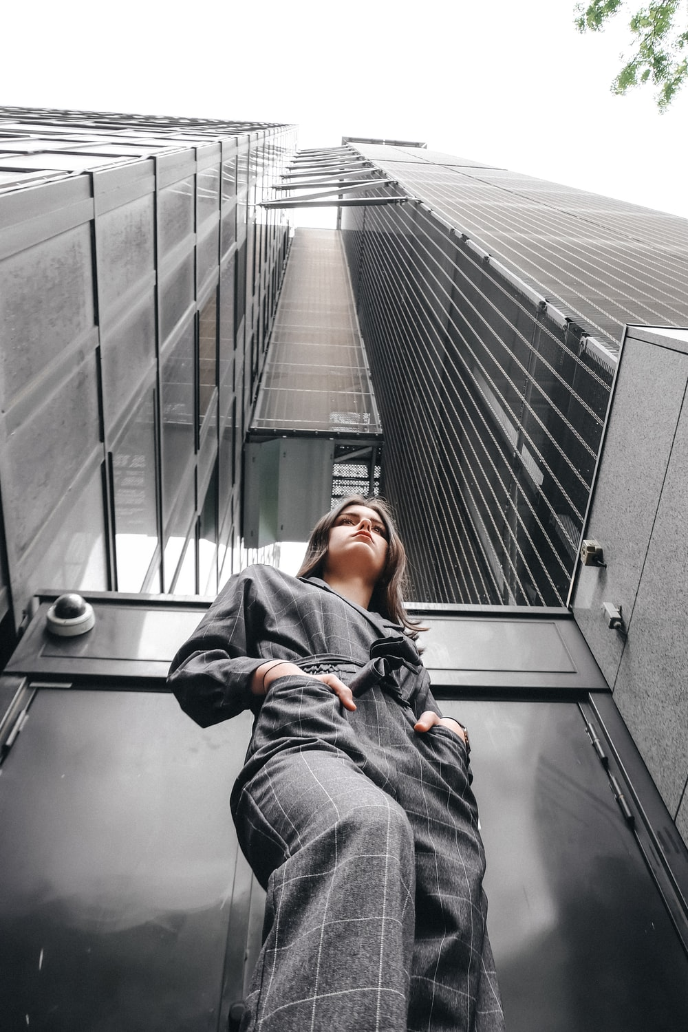 woman standing in front of high-rise building