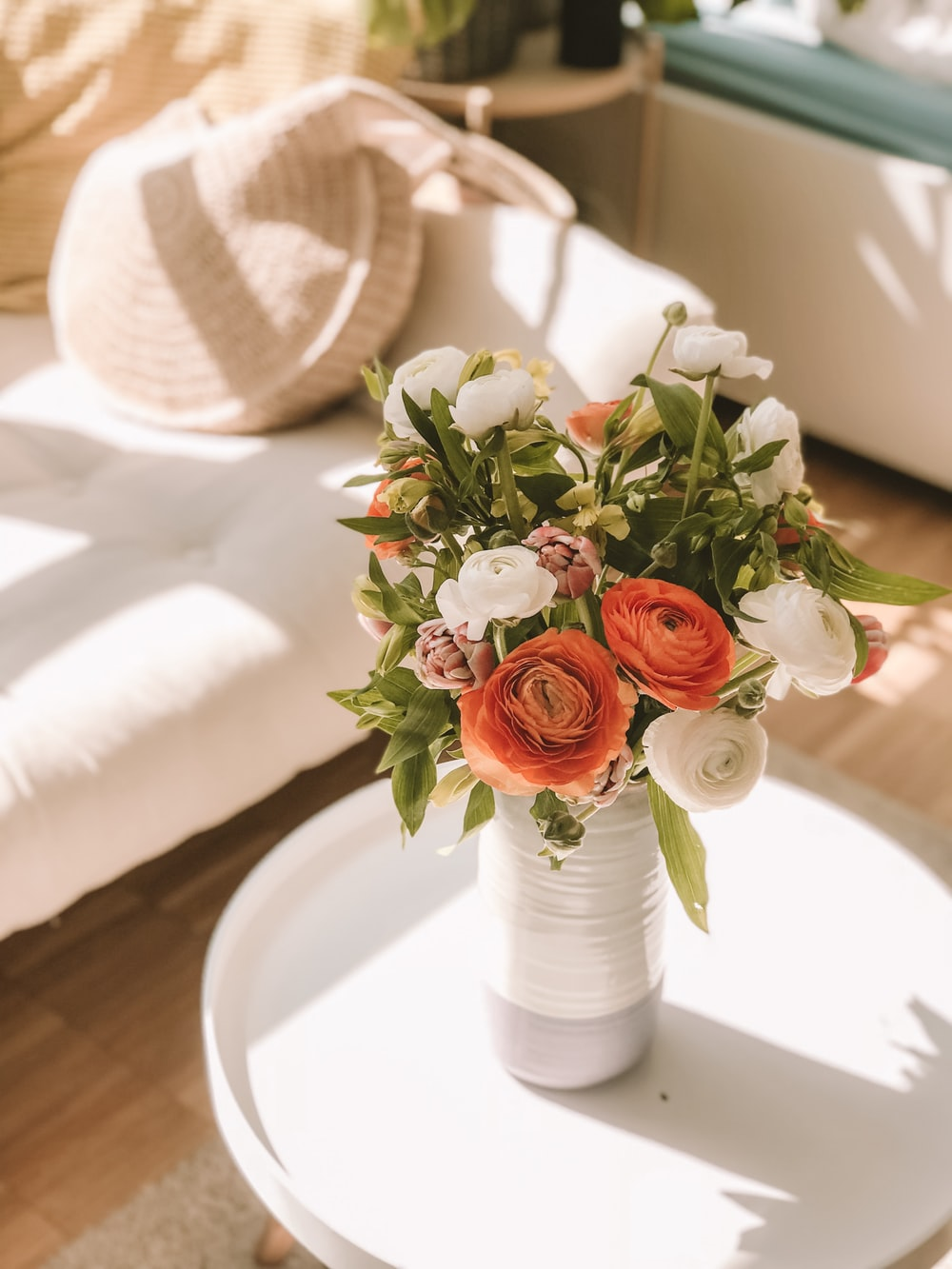 white and red flowers in vase