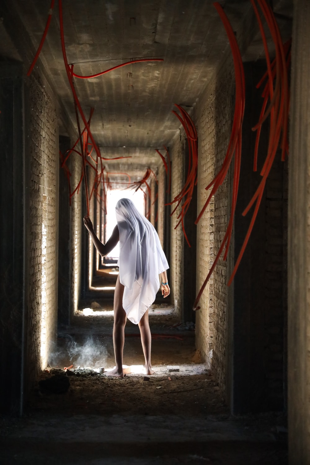 person covered on white textile in room