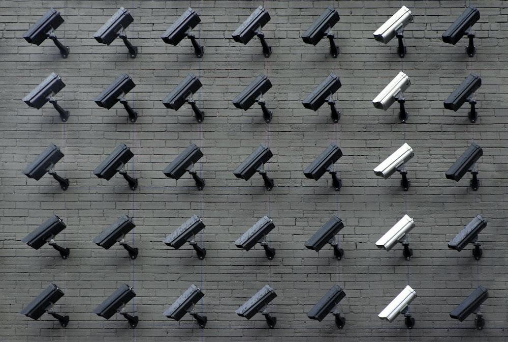 assorted-color security cameras