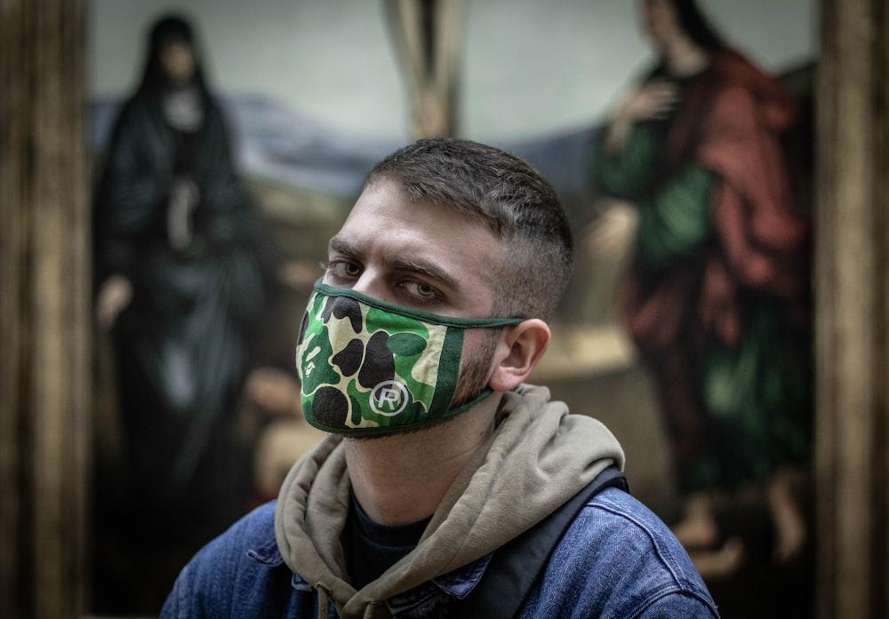 man wearing green camouflage mask