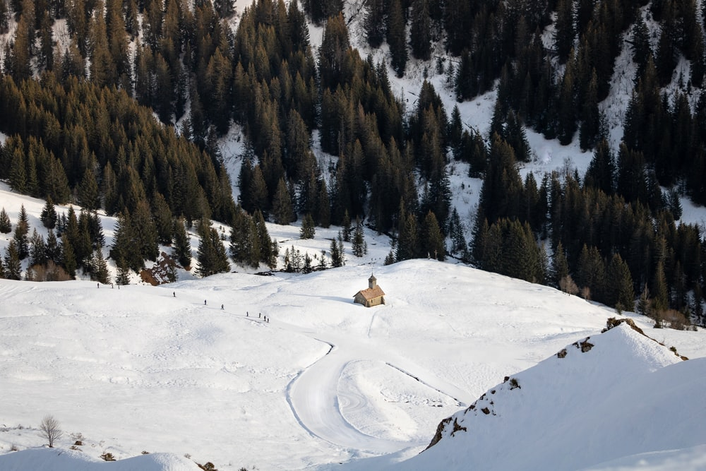 aerial view of brown house on ice covered field