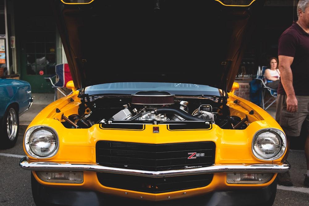 open hood of yellow car
