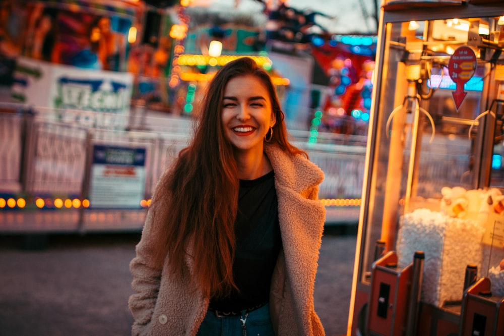 smiling woman wearing brown coat