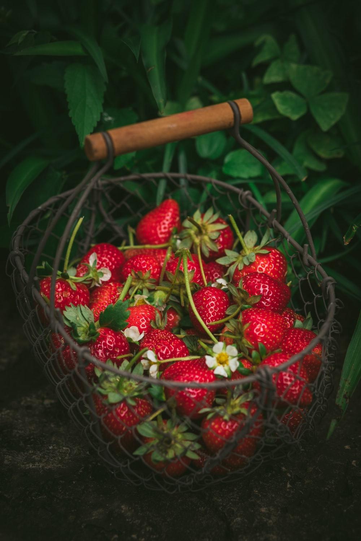 strawberries in metal basket