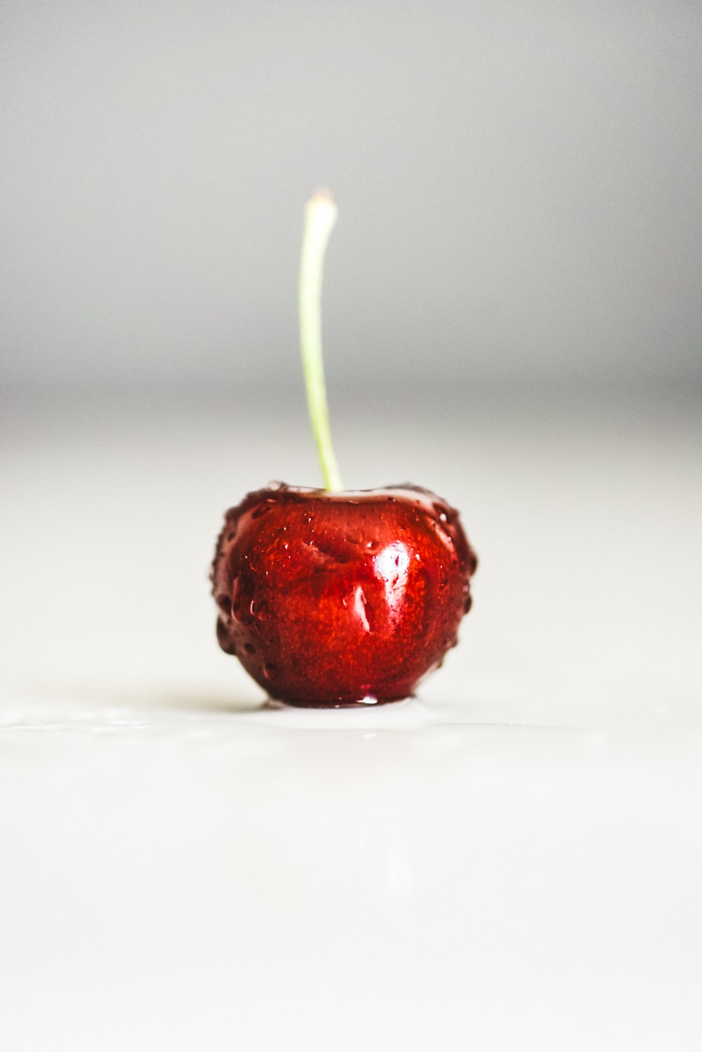 red cherry fruit on white background