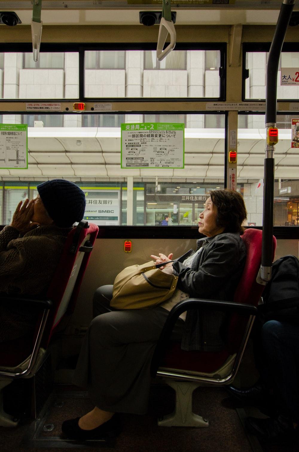 woman sitting inside vehicle seat during daytime
