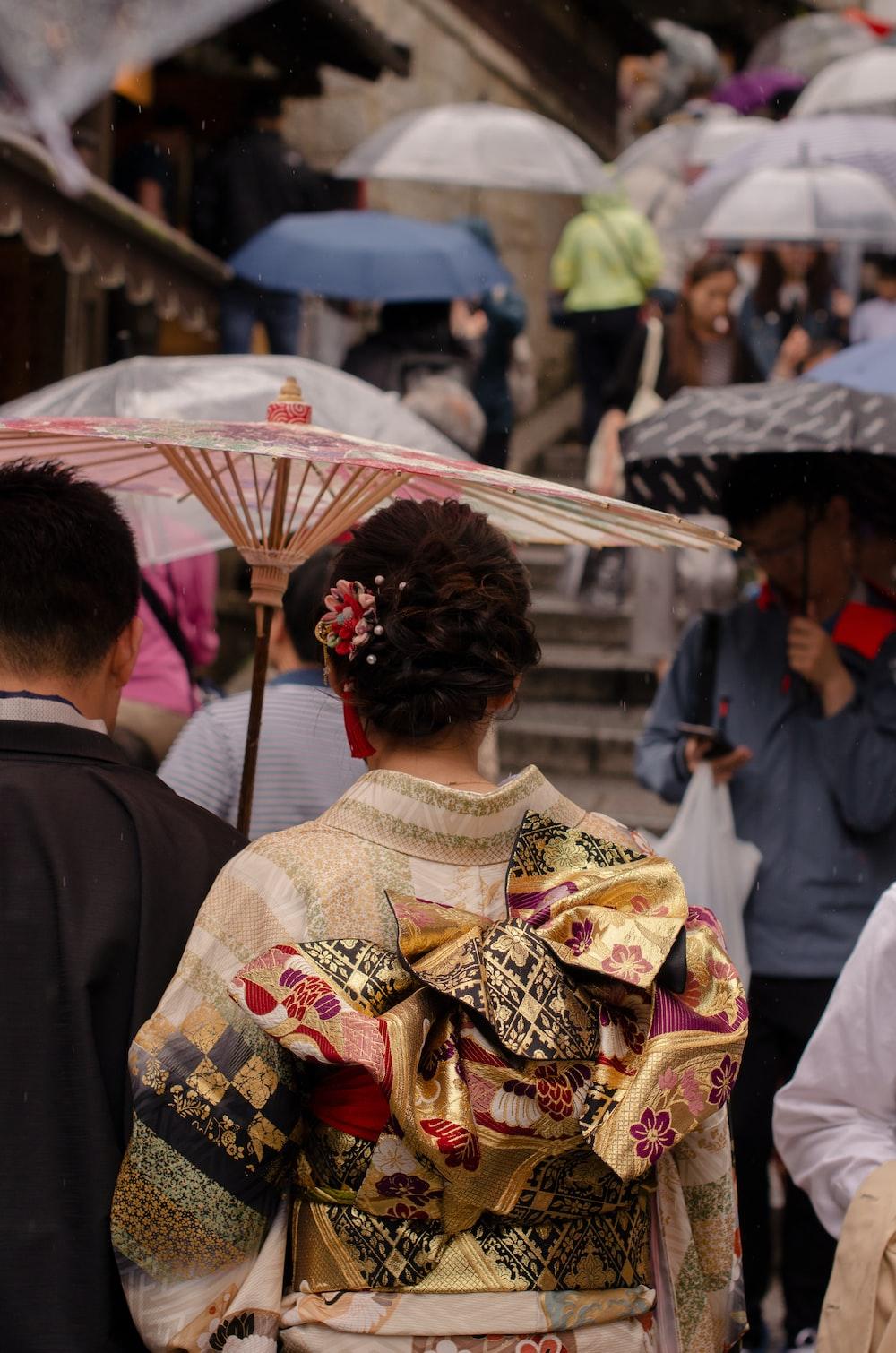 people using umbrellas