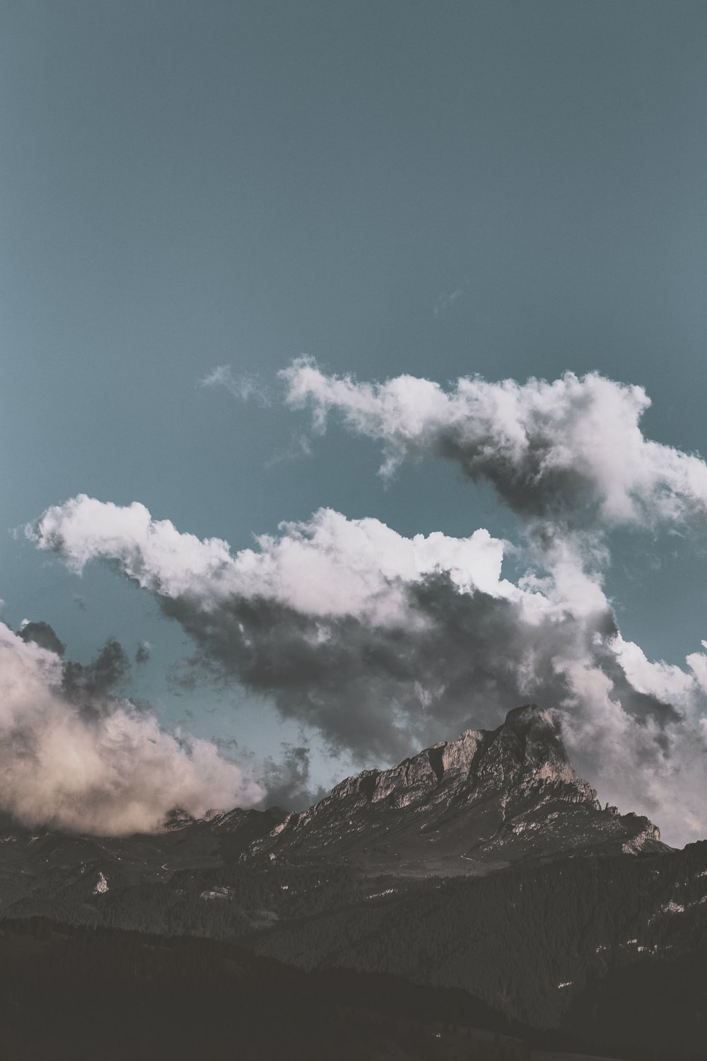 mountain and clouds during day