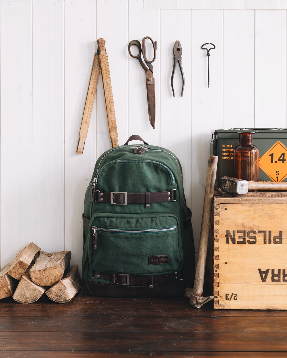green backpack near wall