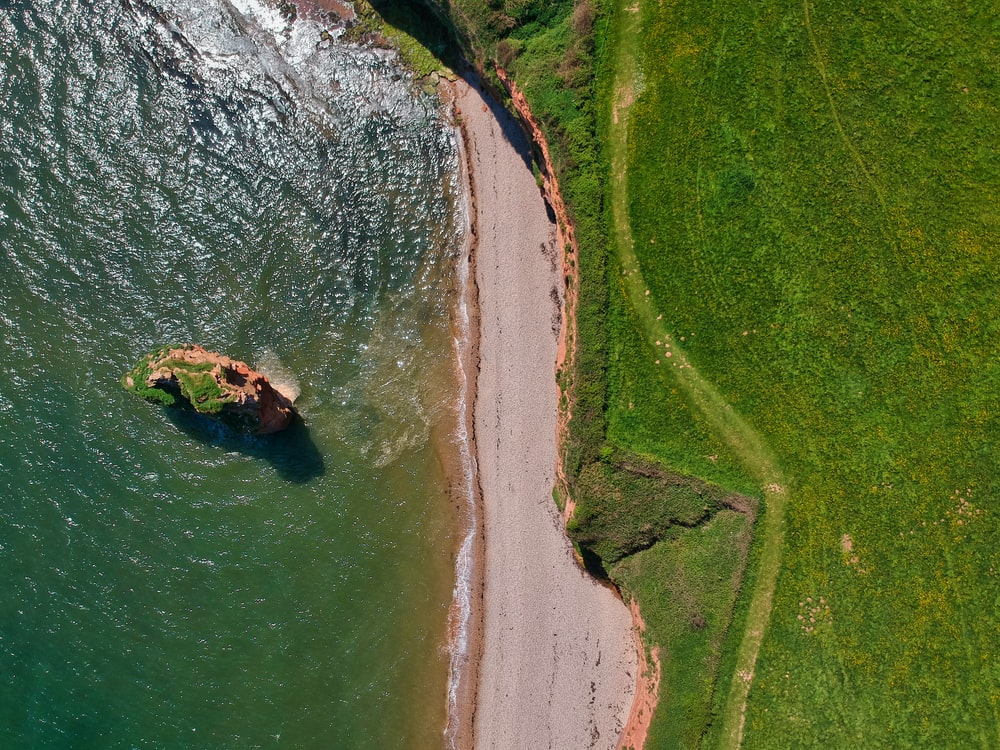 An aerial image of the SW Coast Path separating the sea from the land