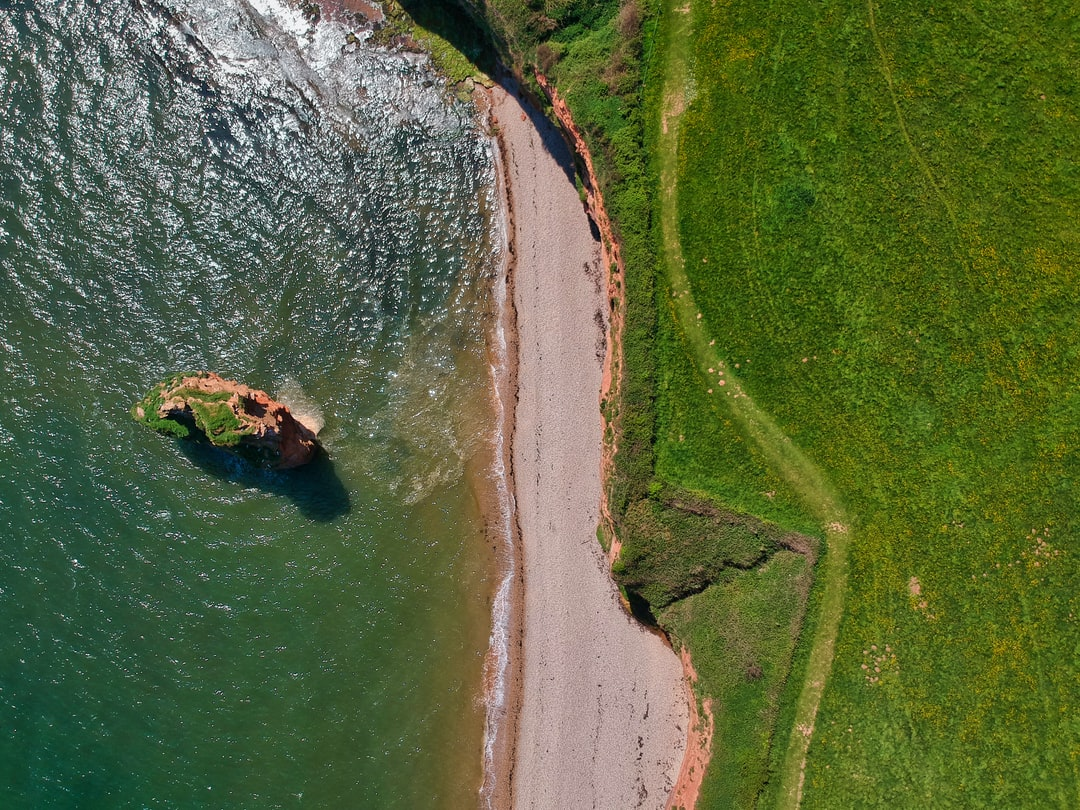 Jousting with the seagulls to get this top-down view of Ladram Bay in Devon, UK, with the SW Coast Path visible on the right.