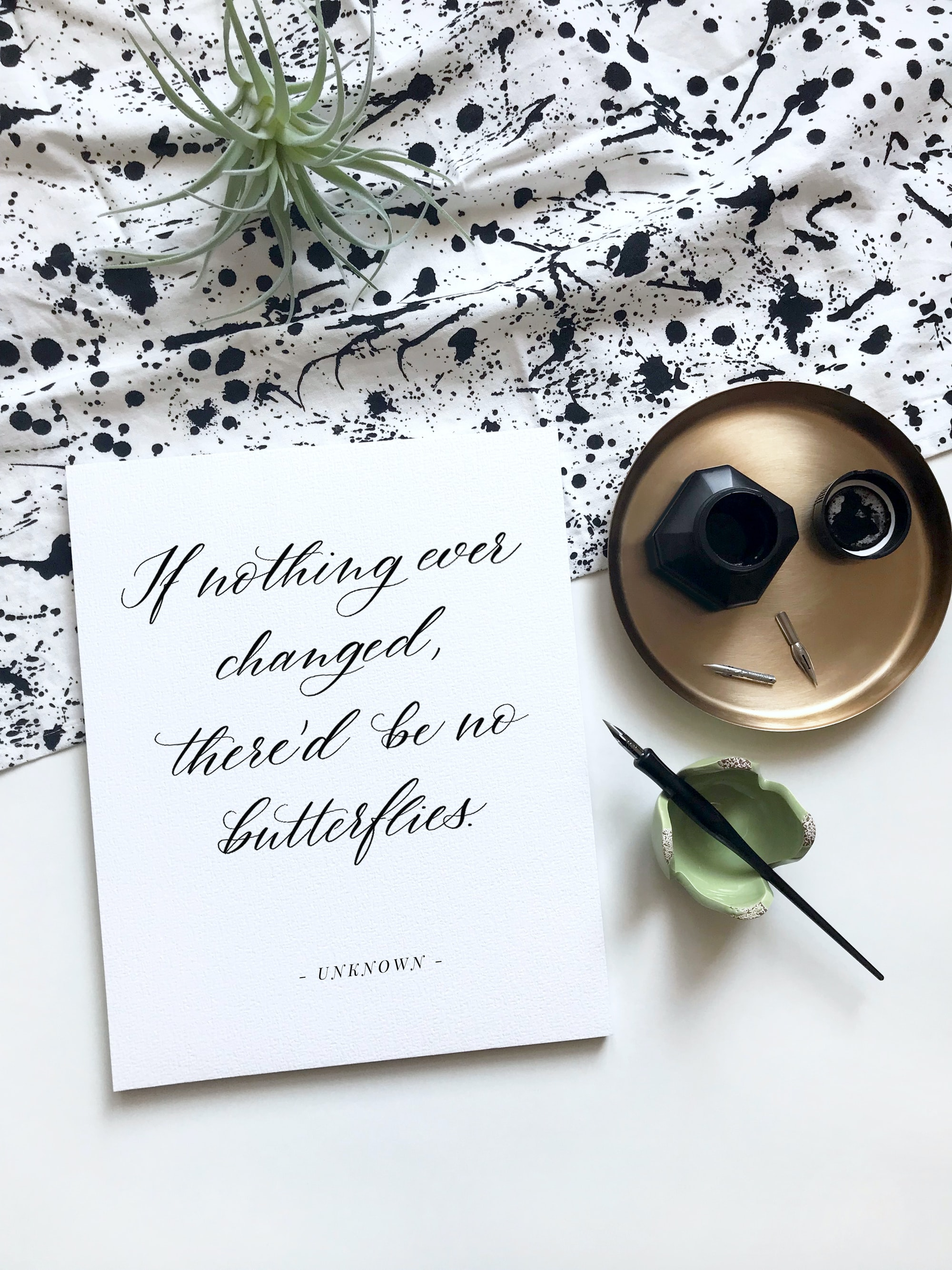 Flatlay arrangement with writing pad