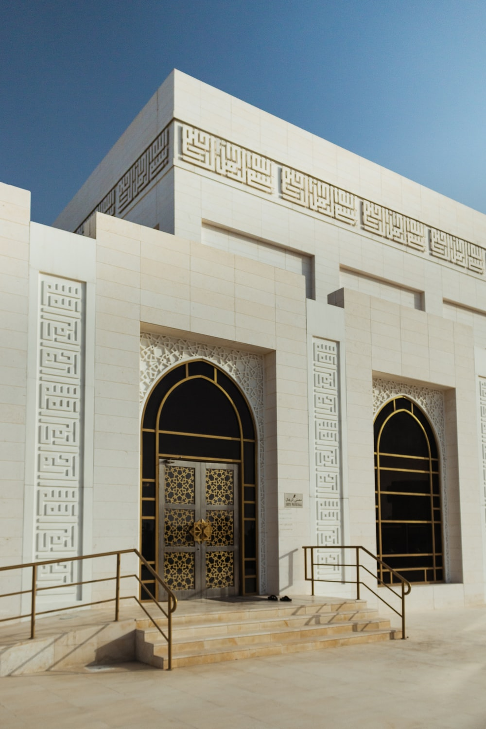 white concrete building with arch doors