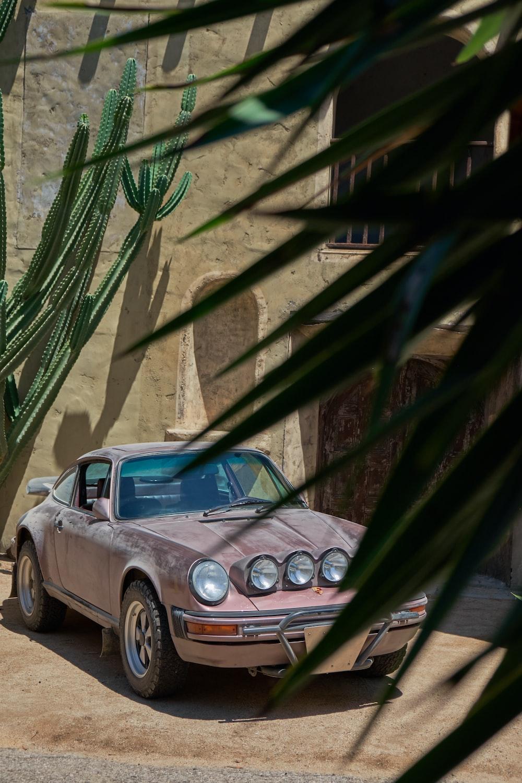 brown vehicle parked near concrete building
