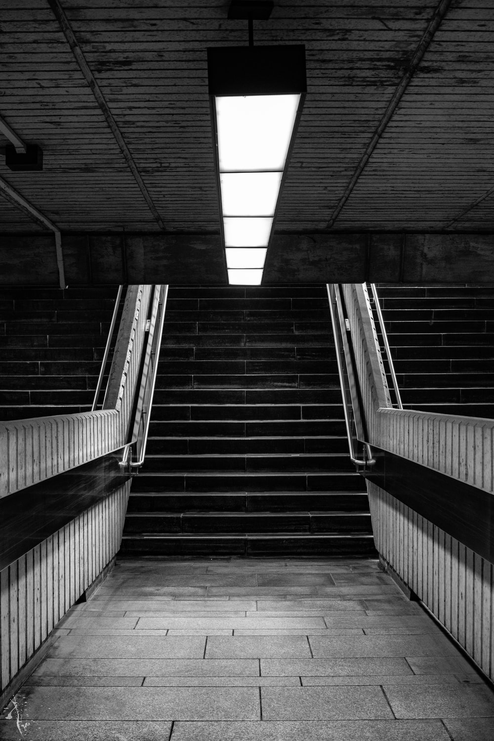 grayscale photography of subway stairs