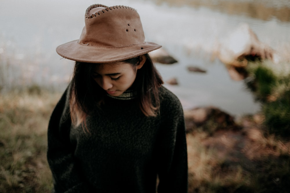woman wearing black sweater and brown cowboy hat