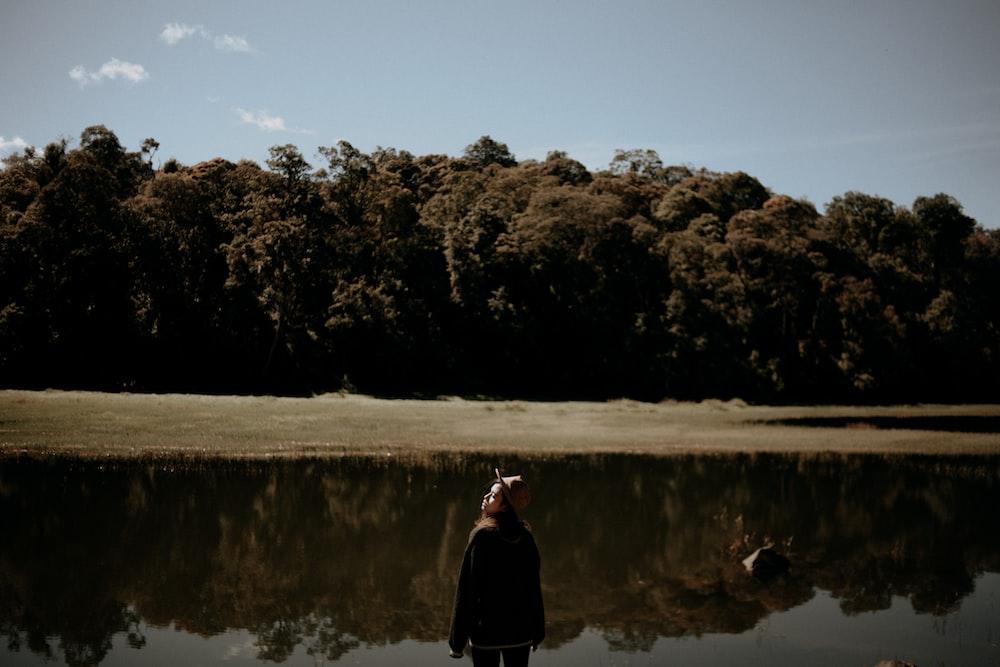 woman standing near the lake