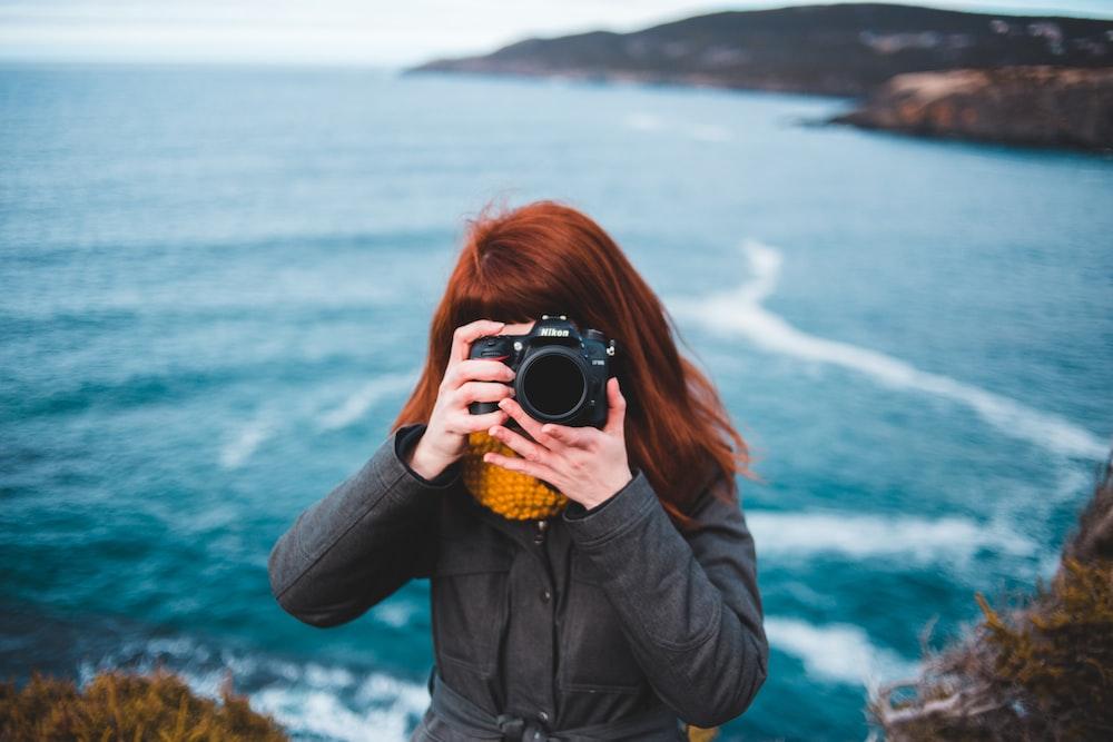 woman taking photo photography