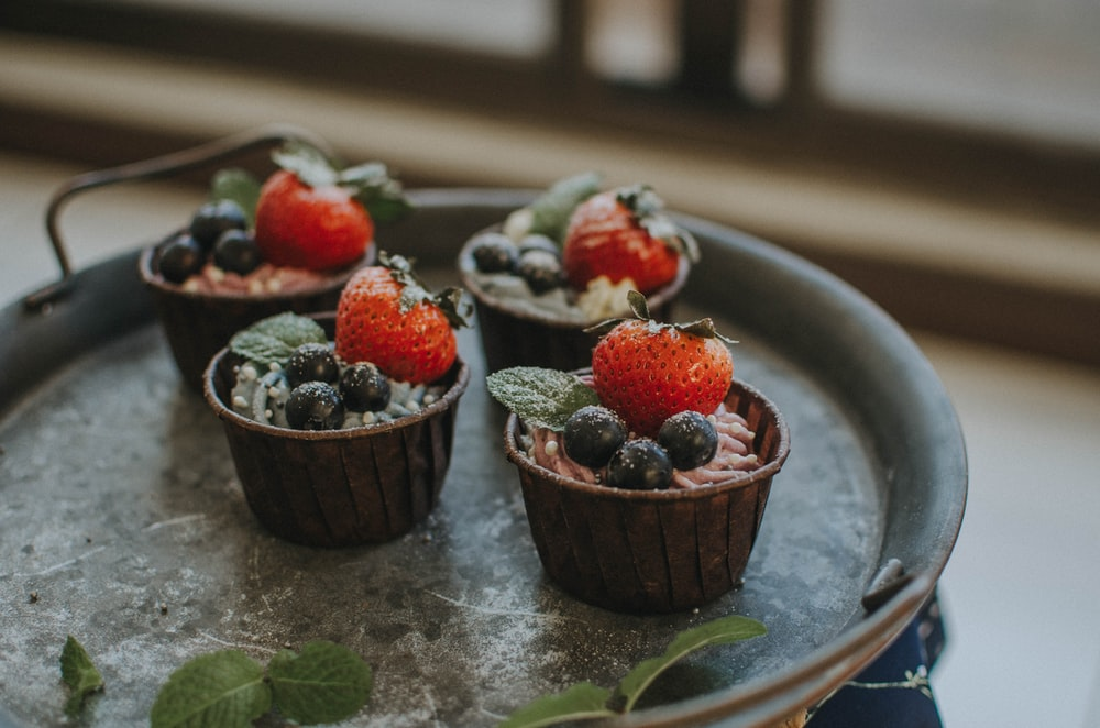 strawberry cupcakes on black tray