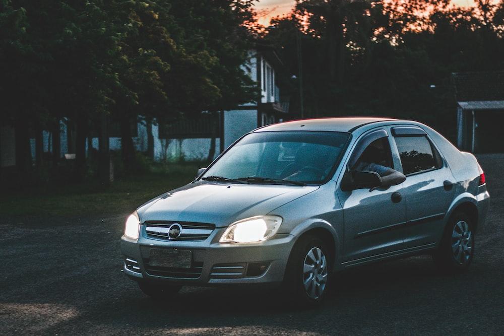 gray Opel sedan park outside during golden hour