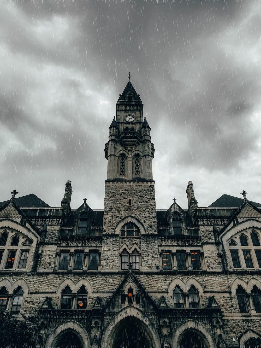 grey concrete church during rainy day