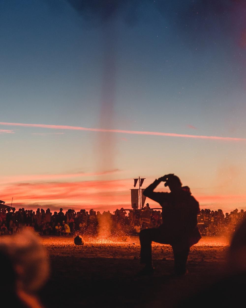 man wearing jacket during sunset