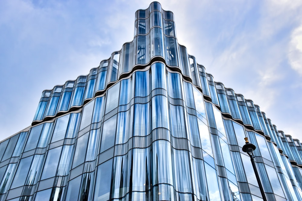 low angle photo of glass curtain building