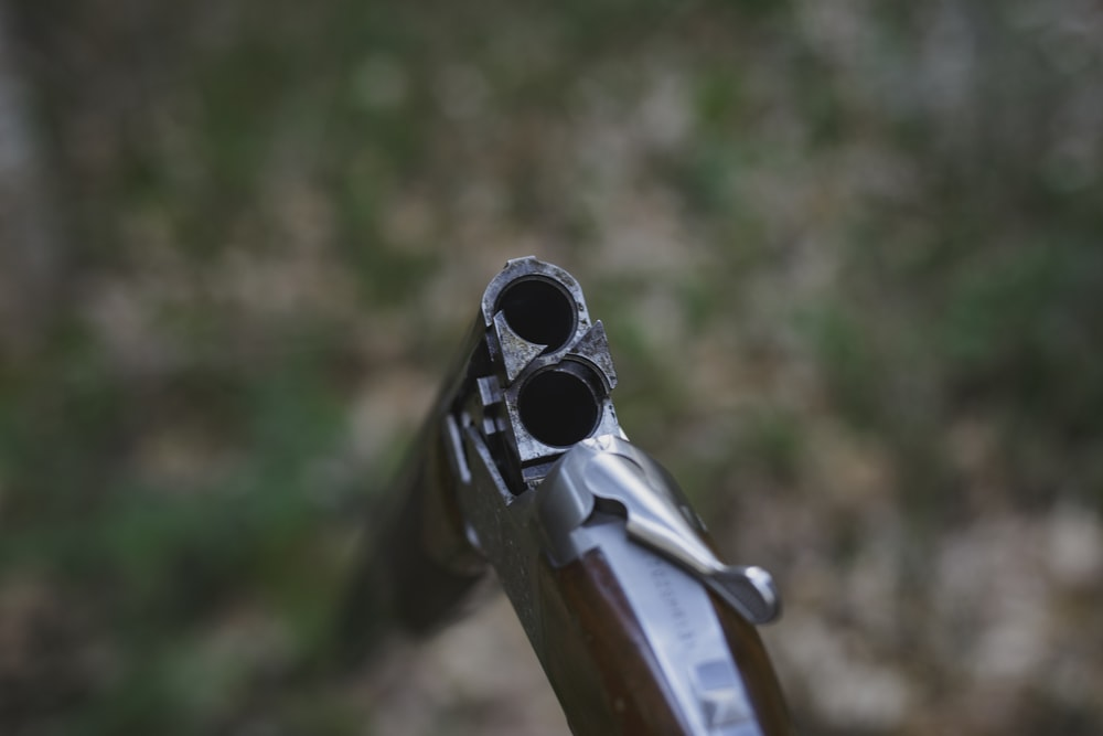 shallow focus photo of brown rifle