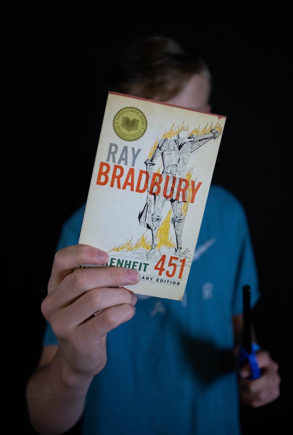 person holding Ray Bradbury book