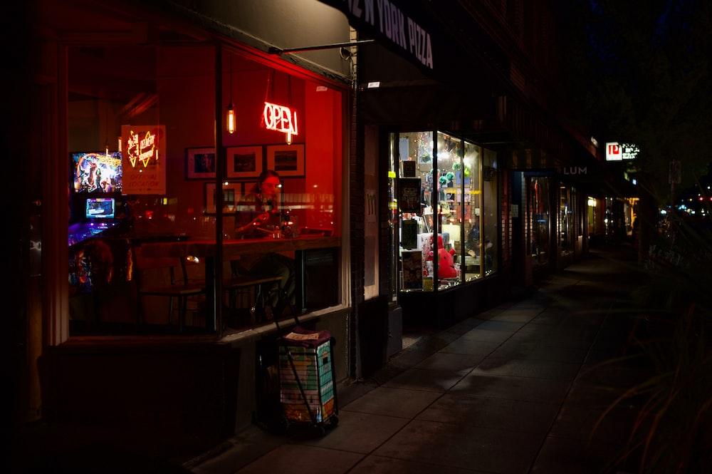 lighted stores beside street