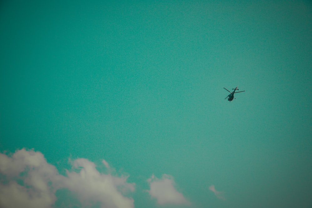 black helicopter in flight