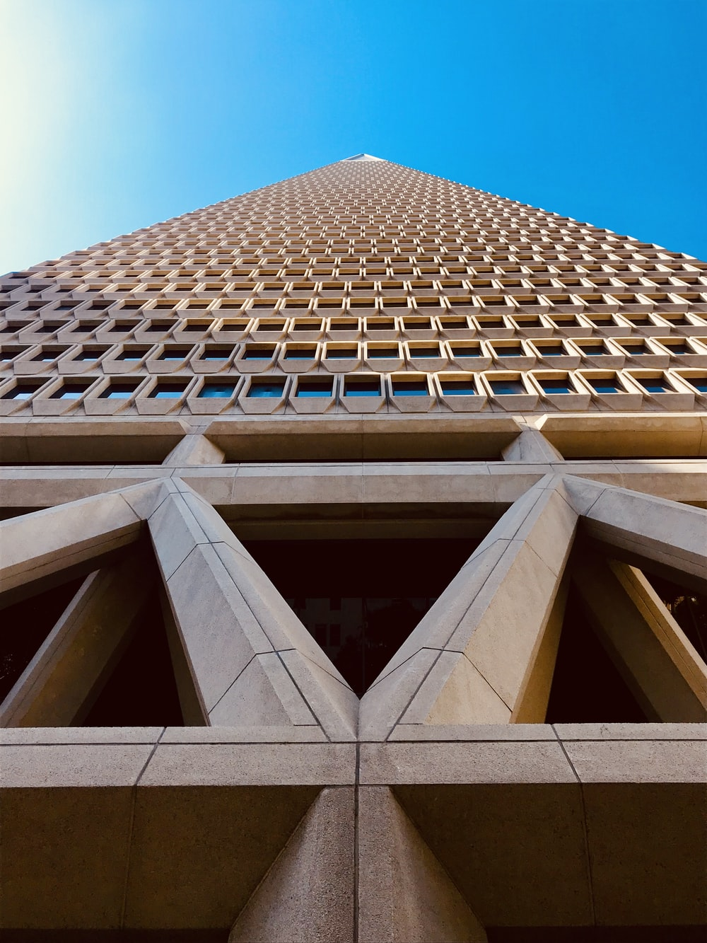 worms-eye-view photography of brown building