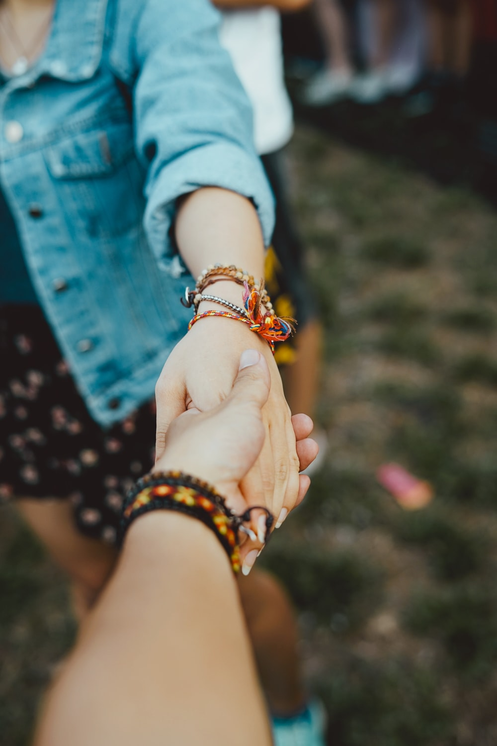 person holding hand of woman
