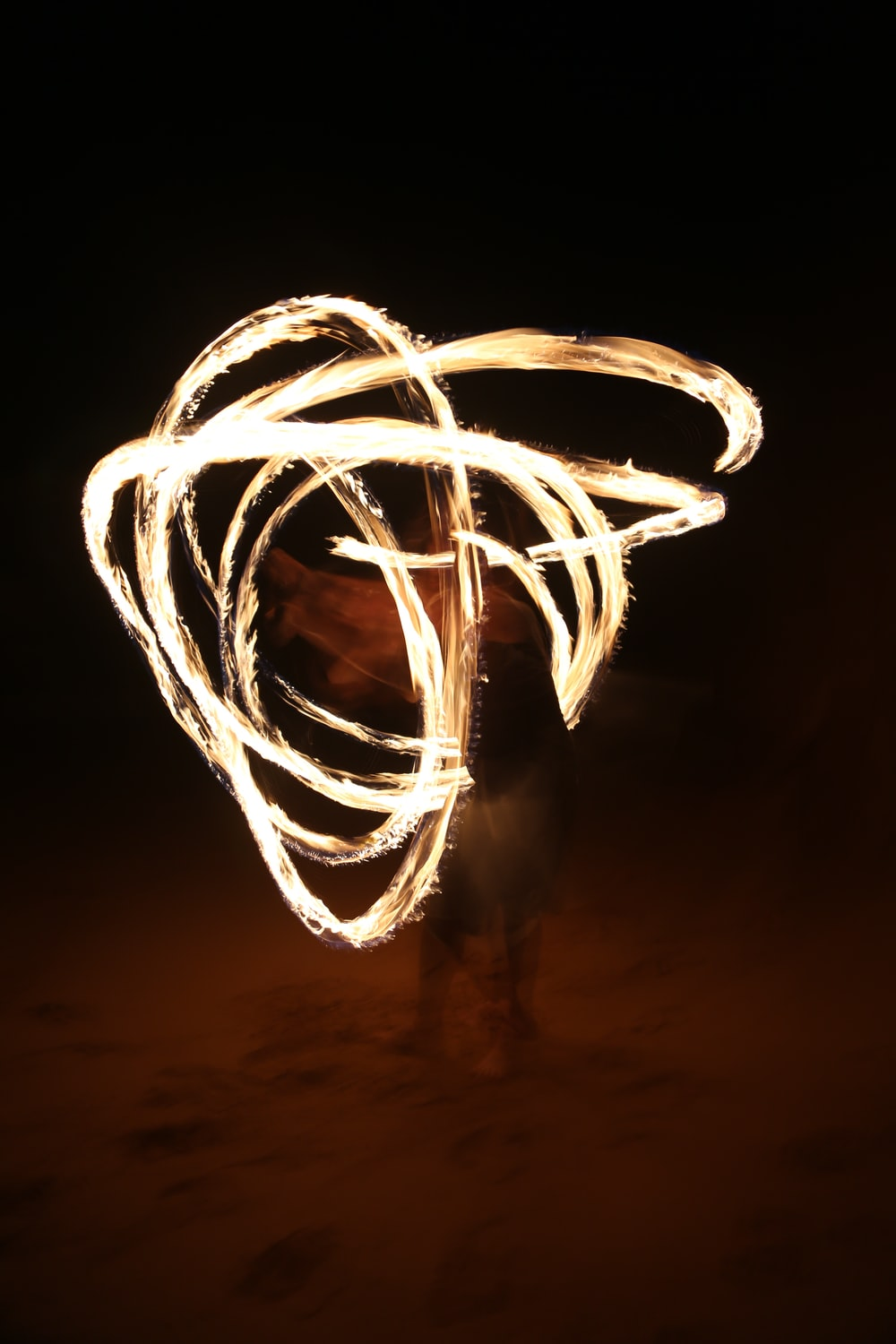 fire dancing at night time