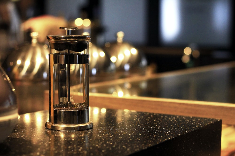 grey metal coffee press on counter